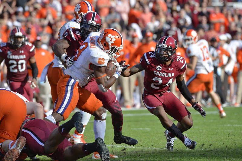 Clemson running back Wayne Gallman rushes through the Gamecock defense for a first down during the second half of an NCAA college football game against South Carolina Saturday, Nov. 28, 2015, in Columbia, S.C. Clemson won 37-32. (AP Photo/Richard Shiro)