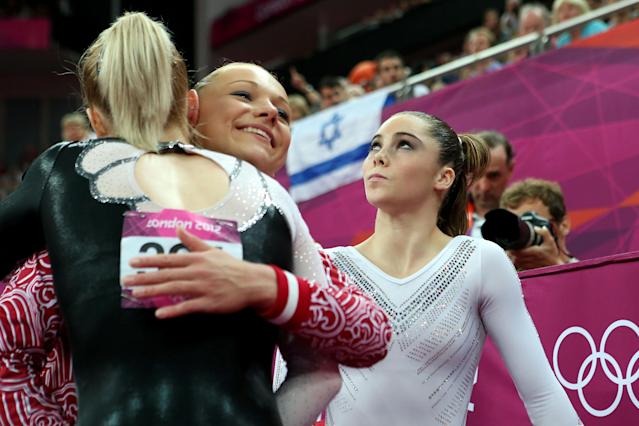 (L-R) Sandra Raluca Izbasa of Romania and Maria Paseka of Russia embrace as McKayla Maroney of the United States looks on during the Artistic Gymnastics Women's Vault Final on Day 9 of the London 2012 Olympic Games at North Greenwich Arena on August 5, 2012 in London, England. (Photo by Ronald Martinez/Getty Images)