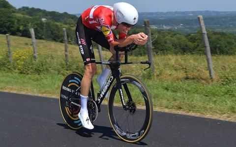 <span>Kasper Asgreen gets stuck into his time trial</span> <span>Credit: GETTY IMAGES </span>