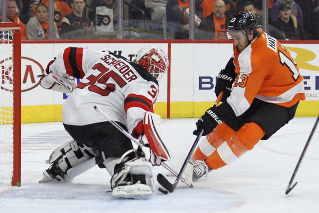 New Jersey Devils' Cory Schneider blocks the shot of Philadelphia Flyers' Kevin Hayes during the second period of an NHL hockey game Wednesday, Oct. 9, 2019, in Philadelphia. (AP Photo/Tom Mihalek)