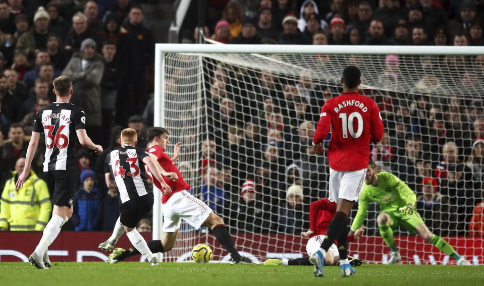 Newcastle United's Matthew Longstaff, second left, scores his side's first goal of the game during their English Premier League soccer match against Manchester United at Old Trafford, Manchester, England, Thursday, Dec. 26, 2019. (Martin Rickett/PA via AP)