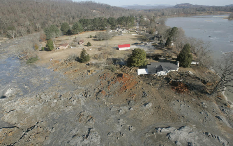 FILE - In this Dec. 22, 2008 file photo, an aerial view shows homes that were destroyed when a retention pond wall collapsed at the Tennessee Valley Authorities Kingston Fossil Plant in Harriman, Tenn. U.S. District Court Judge Thomas Varlan ruled Thursday, Aug. 23, 2012 that The Tennessee Valley Authority is liable for the huge spill of toxin-laden sludge. Varlan said in a written opinion that TVA was negligent in its conduct and will be liable for damages to be determined later. (AP Photo/Wade Payne, File)