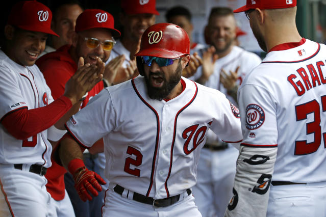 Washington Nationals' Adam Eaton (2) celebrates his solo home run with teammates in the dugout in the fifth inning of the first baseball game of a doubleheader against the Colorado Rockies, Wednesday, July 24, 2019, in Washington. Washington won 3-2. (AP Photo/Patrick Semansky)