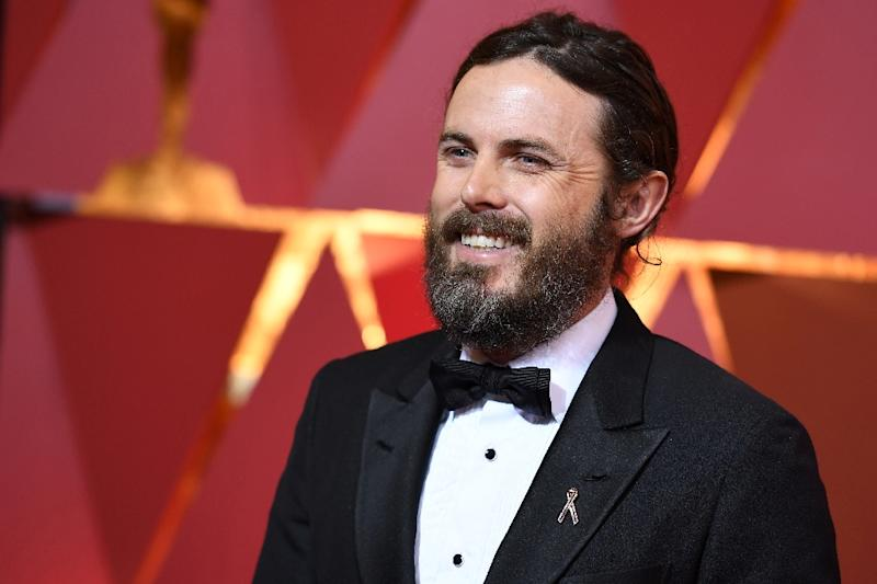 "Amazon won two Oscars for gritty family drama ""Manchester by the Sea,"" which collected statuettes for best original screenplay and best actor Casey Affleck (AFP Photo/ANGELA WEISS)"