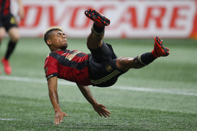 Atlanta United forward Josef Martinez (7) battles for there ball in the first half of an MLS soccer game against the D.C. United on Sunday, March 11, 2018, in Atlanta. (AP Photo/Todd Kirkland)