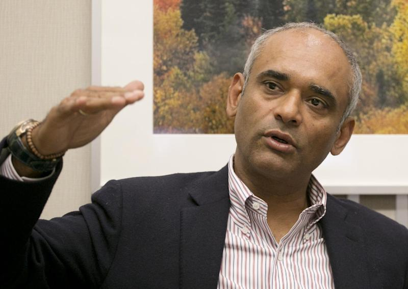 In this Wednesday, March 26, 2014 photo, Chet Kanojia, the founder and CEO of Aereo, speaks during an interview with The Associated Press, in New York. The future of Aereo, an online service that provides over-the-air TV channels, hinges on a battle with broadcasters that goes before the U.S. Supreme Court in late April 2014. (AP Photo/Mark Lennihan)
