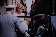 <p>(Photo by Franco Origlia/Getty Images) Two months before her divorce is finalised, Diana is photographed leaving a cafe during a private trip to Rome.</p>