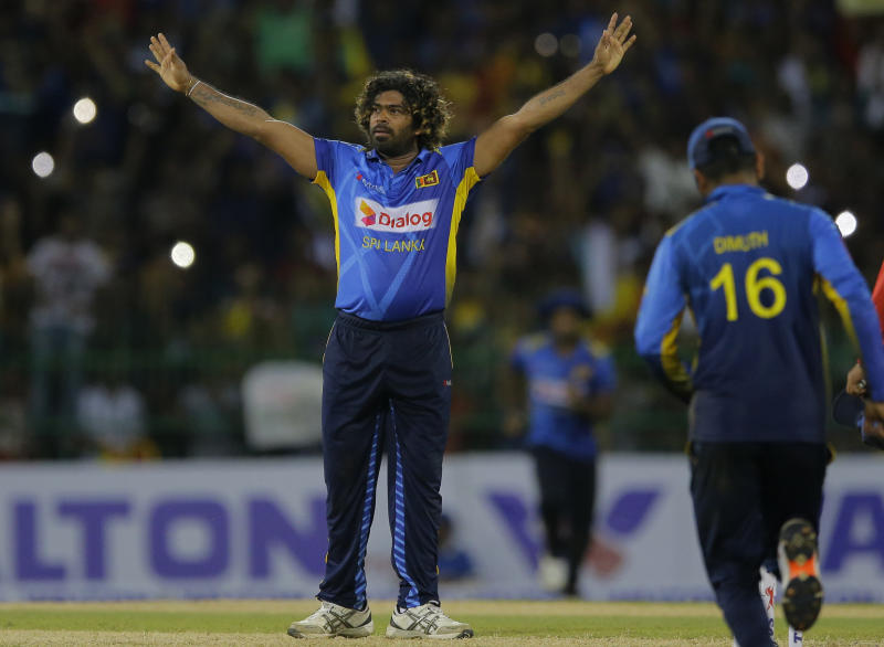 Sri Lanka's bowler Lasith Malinga who played his career last one-day international cricket match acknowledges the crowd after Sri Lanka defeated Bangladesh by 91 runs in the first one-day international cricket match between Sri Lanka and Bangladesh in Colombo, Sri Lanka, Friday, July 26, 2019. (AP Photo/Eranga Jayawardena)