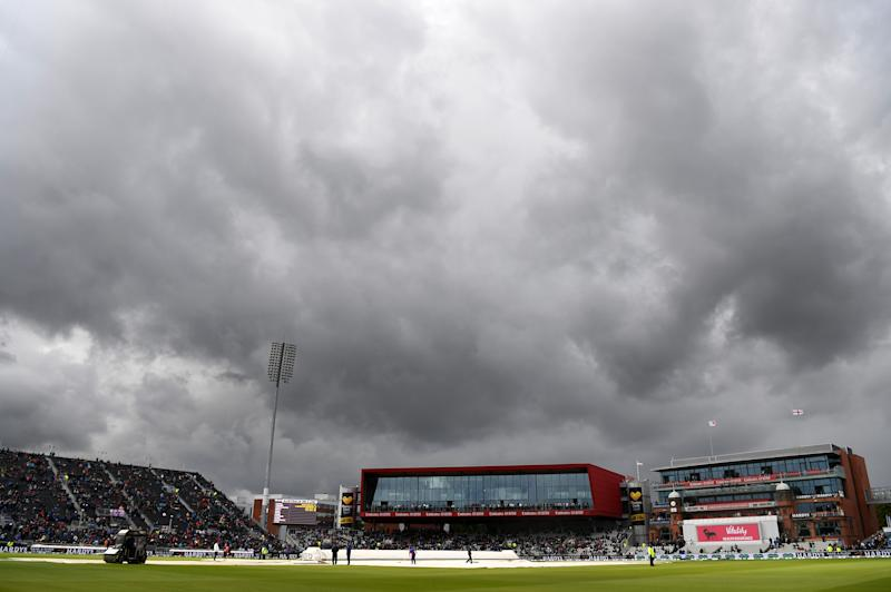 MANCHESTER, ENGLAND - SEPTEMBER 04: A general view of Old Trafford as the grounds staff attempts to clear the covers of water during Day One of the 4th Specsavers Ashes Test between England and Australia at Old Trafford on September 04, 2019 in Manchester, England. (Photo by Alex Davidson/Getty Images)