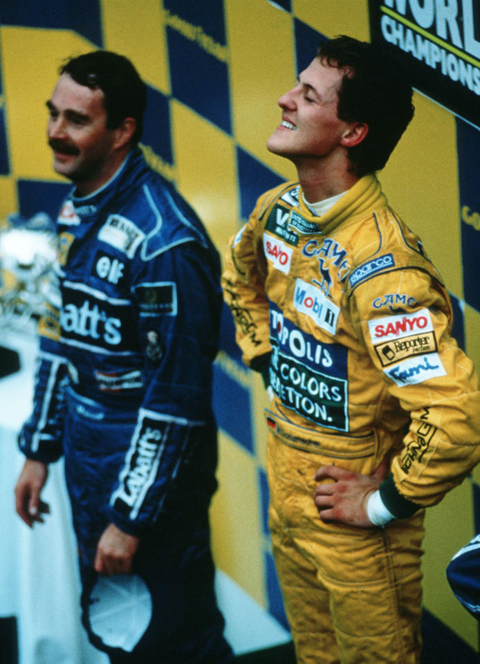 SPA FRANCORCHAMPS, BELGIUM - AUGUST 30: Michael Schumacher (R) of Germany and Benetton-Ford celebrates after winning his first Formula One Grand Prix at the Spa Francorchamps Circuit on August 30, 1992 in Spa Francorchamps, Belgium. (Photo by Bongarts/Getty Images)