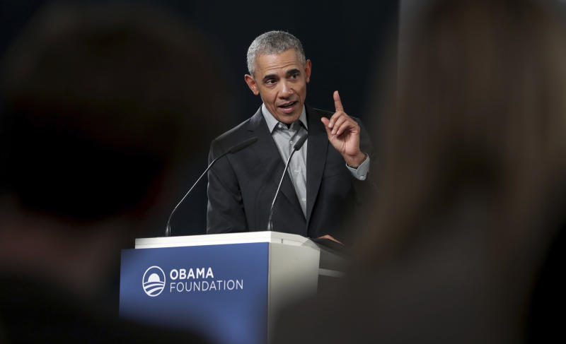 """FILE - In this April 6, 2019, file photo former President Barack Obama gestures as he speaks during a town hall meeting at the 'European School For Management And Technology' (ESMT) in Berlin, Germany. On Saturday, May 16, 2020, Obama plans to speak during """"Show Me Your Walk, HBCU Edition,"""" a two-hour livestreaming event for historically black colleges and universities broadcast on YouTube, Facebook and Twitter. (AP Photo/Michael Sohn, File)"""