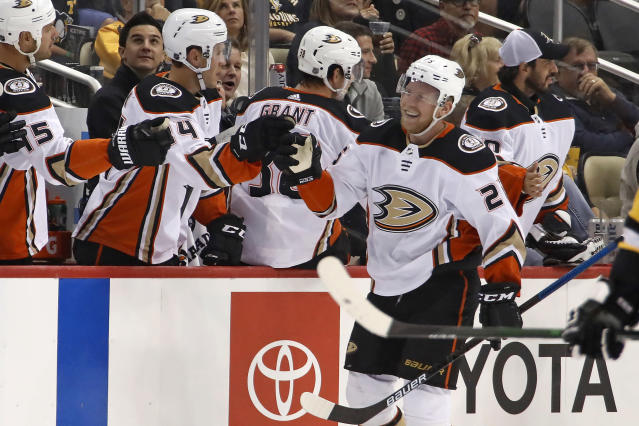 Anaheim Ducks' Ondrej Kase returns to the bench after scoring a goal during the second period of the team's NHL hockey game against the Pittsburgh Penguins in Pittsburgh, Thursday, Oct. 10, 2019. (AP Photo/Gene J. Puskar)