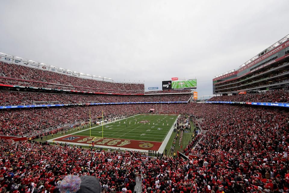 Fans at Levi's Stadium watch as the Green Bay Packers kickoff to the San Francisco 49ers during the first half of the NFL NFC Championship football game in Santa Clara, Calif. on Jan. 19, 2020.