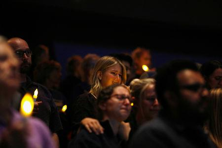 Mourners are seen at a vigil for families of victims of a mass shooting in Thousand Oaks, California, U.S. November 8, 2018. REUTERS/Eric Thayer