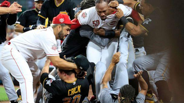 PHOTO: CINCINNATI, OHIO - JULY 30: Amir Garrett (No. 50, middle, white shirt) of the Cincinnati Reds engages members of the Pittsburgh Pirates during a bench clearing altercation July 30, 2019 in Cincinnati (Andy Lyons/Getty Images)