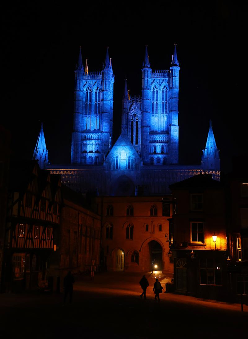 Lincoln Cathedral is lit up in blue in a gesture of thanks to the hardworking NHS staff who are trying to battle coronavirus. (Photo: PA)