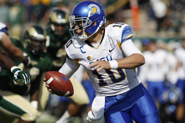 San Jose State quarterback David Fales rolls out to throw an 83-yard pass for a touchdown against Colorado State in the second quarter of an NCAA college football game in Fort Collins, Colo., on Saturday, Oct. 12, 2013. (AP Photo/David Zalubowski)