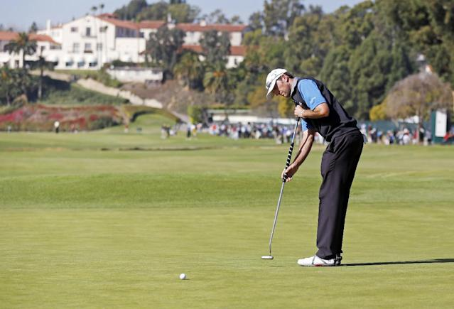 Jason Allred putts on the first green in the final round of the Northern Trust Open golf tournament at Riviera Country Club in the Pacific Palisades area of Los Angeles, Sunday, Feb. 16, 2014. Allred was a Monday qualifier and tied for third place in the final round Sunday. The tie for third was a career-best for the 33-year-old Allred. He earned $388,600, which is more than he had made in his entire career, which included two full seasons on the PGA Tour. (AP Photo/Reed Saxon)