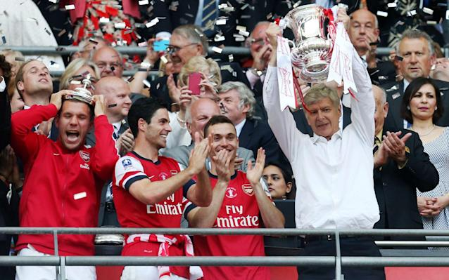 <span>Arsene Wenger signed a new contract after Arsenal's FA Cup win in 2014</span> <span>Credit: Action Images </span>