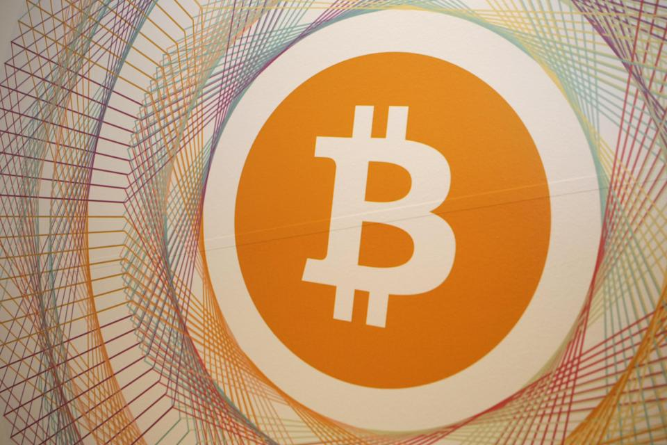 The Bitcoin logo in the first Italian Bitcoin crypto currency shop 'Bitcoin Compro Euro' (meaning I Buy Euro), in Rovereto, northern Italy. Photo: PIERRE TEYSSOT/AFP/Getty Images