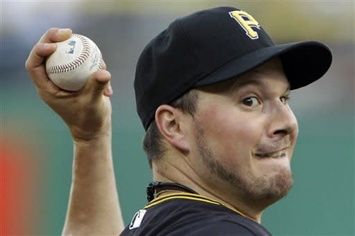 Pittsburgh Pirates pitcher Erik Bedard delivers during the first inning of a baseball game against the Arizona Diamondbacks in Pittsburgh Monday, Aug. 6, 2012. (AP Photo/Gene J. Puskar)