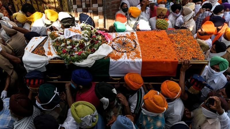 Family members and villagers carry the coffin of soldier Satnam Singh who was was killed in a recent clash with Chinese forces in the Galwan valley area, during the cremation ceremony at Bhojraj village near Gurdaspur on June 18, 2020