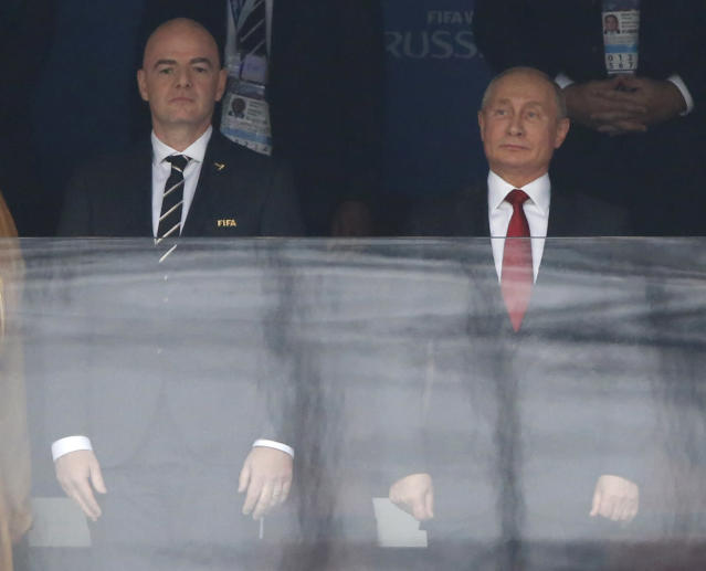 FIFA President Gianni Infantino, left, and Russian President Vladimir Putin stand for the athem prior to the match between Russia and Saudi Arabia which opens the 2018 soccer World Cup at the Luzhniki stadium in Moscow, Russia, Thursday, June 14, 2018. (AP Photo/Hassan Ammar)