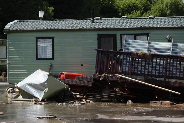 Caravans and tents are damaged by flash floods at Riverside Caravan Park, near the village of Talybont on June 9, 2012 in Aberystwyth, Wales. Severe flooding has affected mid Wales with a major rescue operation under way taking to safety nearly 100 people so far. (Photo by Christopher Furlong/Getty Images)