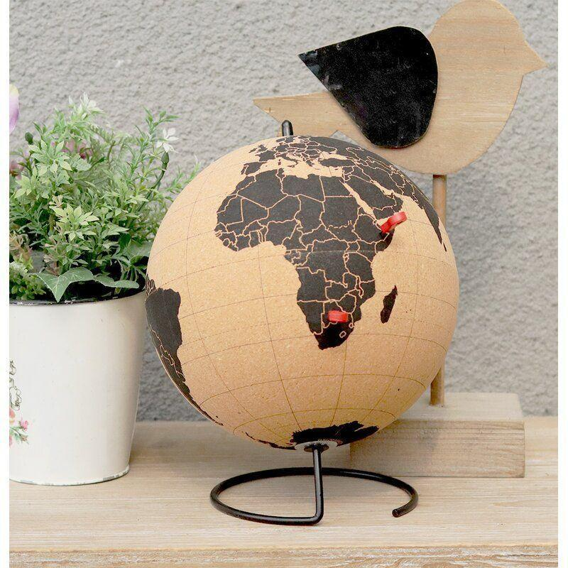 """<p><strong>World Menagerie</strong></p><p>wayfair.com</p><p><strong>$66.90</strong></p><p><a href=""""https://go.redirectingat.com?id=74968X1596630&url=https%3A%2F%2Fwww.wayfair.com%2Fdecor-pillows%2Fpdp%2Fworld-menagerie-cork-globe-w003516802.html&sref=https%3A%2F%2Fwww.seventeen.com%2Flove%2Fdating-advice%2Fadvice%2Fg1290%2Fboyfriend-valentines-gifts%2F"""" rel=""""nofollow noopener"""" target=""""_blank"""" data-ylk=""""slk:Shop Now"""" class=""""link rapid-noclick-resp"""">Shop Now</a></p><p>Does your man want to be a world traveler? Track his trips with this cork globe that doubles as a sick desk accessory.</p>"""