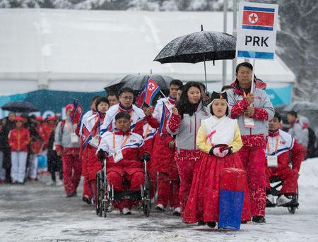 The delegation and the team of North Korea arrive at The Paralympic Village in Pyeongchang, South Korea, March 8, 2018. OIS/IOC/Thomas Lovelock/Handout via Reuters
