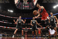 Chicago Bulls guard Zach LaVine (8) looks to pass the ball against the San Antonio Spurs during the first half of an NBA basketball game Monday, Jan. 27, 2020, in Chicago. (AP Photo/David Banks)