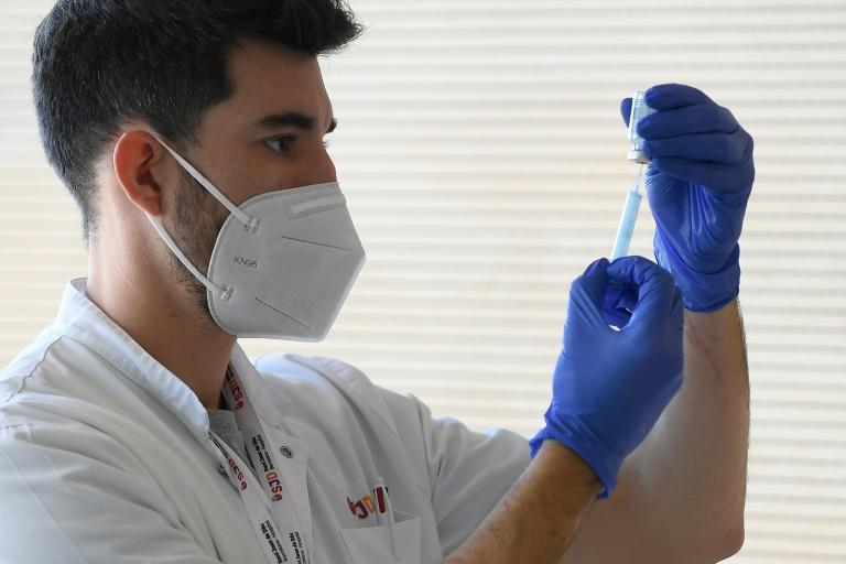 A medical worker prepares a Moderna Covid-19 vaccine at the Hospital Sant Joan de Deu in Barcelona on January 16, 2021
