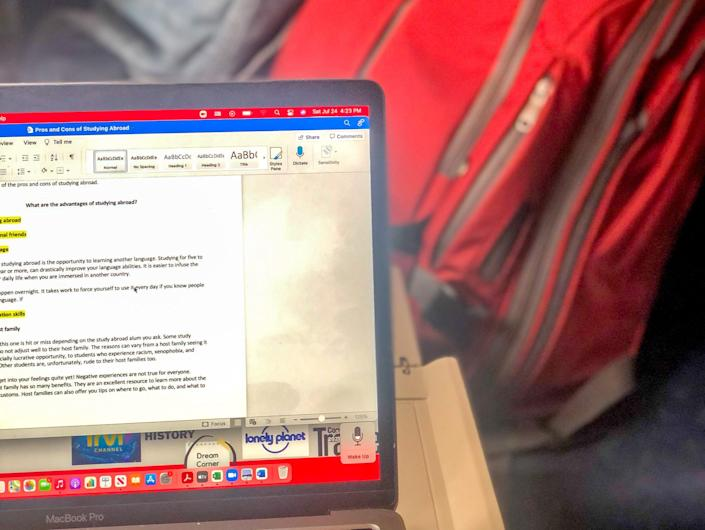 The writer's laptop with a view of the seat and back pack in front