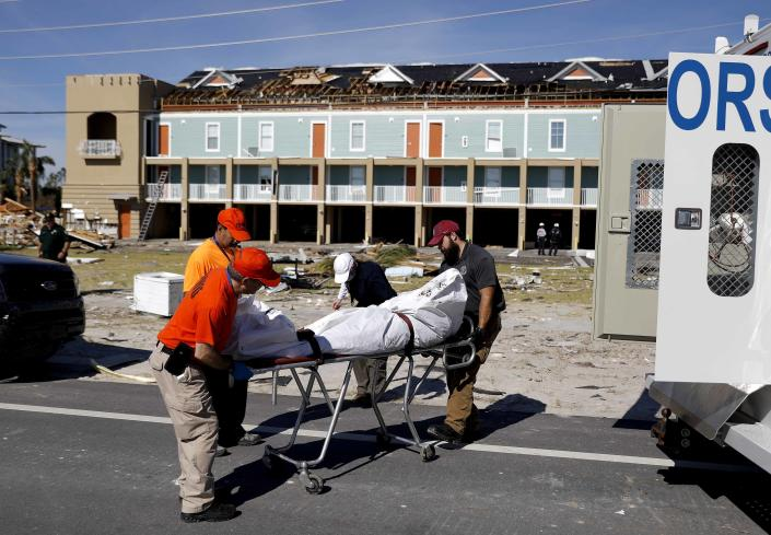 <p>A body is removed after being discovered during the search of a housing structure in the aftermath of hurricane Michael in Mexico Beach, Fla., Friday, Oct. 12, 2018. (Photo: David Goldman/AP) </p>
