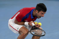 Novak Djokovic, of Serbia, reacts during a semifinal men's tennis match against Alexander Zverev, of Germany, at the 2020 Summer Olympics, Friday, July 30, 2021, in Tokyo, Japan. (AP Photo/Patrick Semansky)