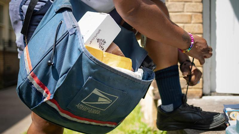 US postal chief backs down on controversial service changes amid outcry