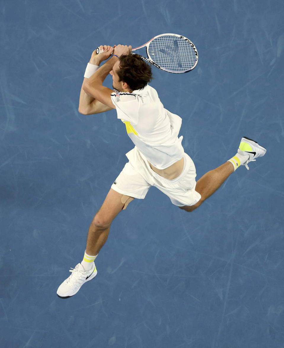 Russia's Daniil Medvedev hits a backhand to Serbia's Novak Djokovic during the men's singles final at the Australian Open tennis championship in Melbourne, Australia, Sunday, Feb. 21, 2021. (AP Photo/Hamish Blair)