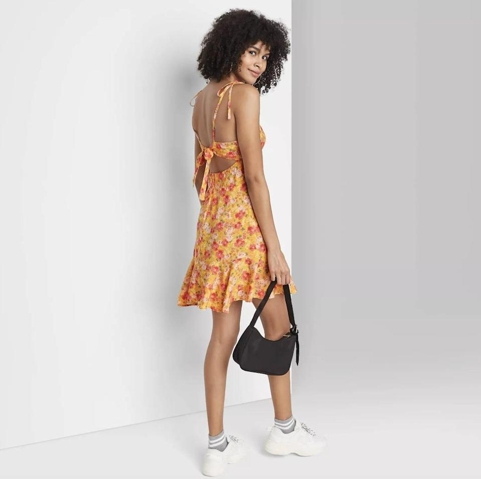 <p>This <span>Wild Fable Sleeveless Tie-Strap Drop Hem Dress</span> ($25) is cut from a breathable fabric, so you'll know you'll be chic and comfortable all day.</p>