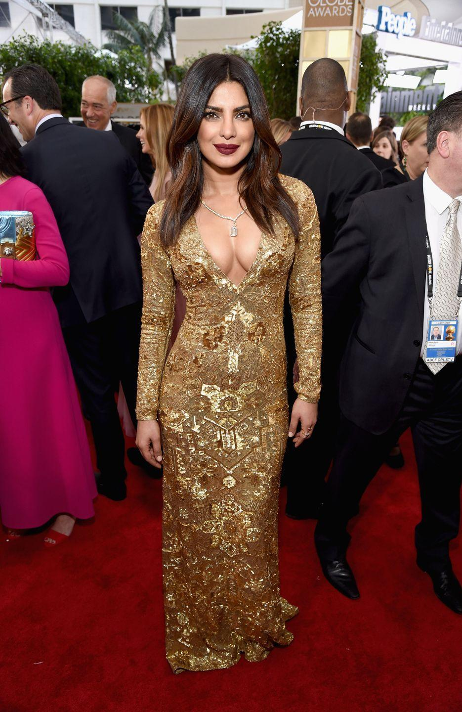<p>An ornate Ralph Lauren gown with plunging neckline was perfection for Chopra's Golden Globes debut in 2017.</p>