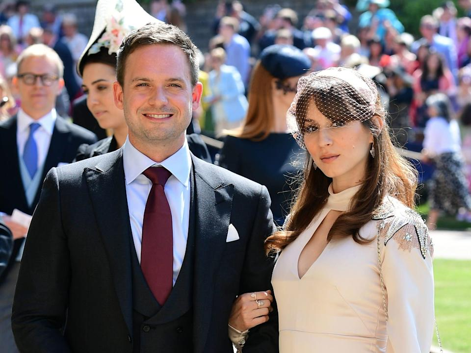 Actor Patrick J. Adams and wife Troian Bellisario arrive at St George's Chapel at Windsor Castle before the wedding of Prince Harry to Meghan Markle.