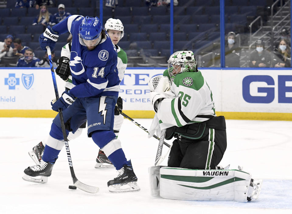 Dallas Stars goaltender Anton Khudobin (35) makes a save as Tampa Bay Lightning left wing Pat Maroon (14) looks for a rebound during the second period of an NHL hockey game Friday, May 7, 2021, in Tampa, Fla. (AP Photo/Jason Behnken)
