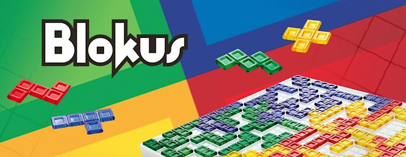 Design of the Blokus box with colored pieces and game board.