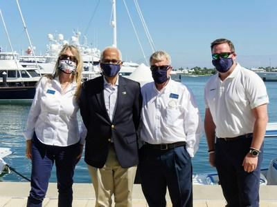 Bahamas Minister of Tourism Dionisio D'Aguilar (2nd left) takes time out to meet with Susan & Tyrone Roberts of Nassau Yacht Haven and Bran Arnold (far right) of Snag-A-Slip Booking Agency.