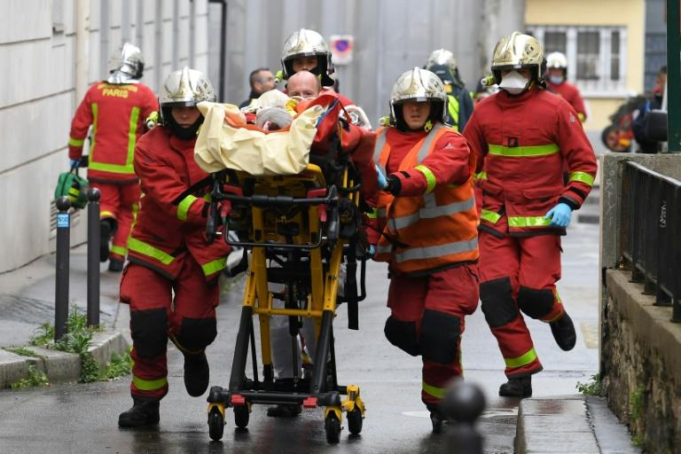 Man held on terror charges after two wounded in Paris knife attack