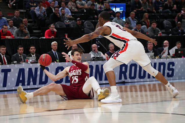 <p>Ivan Aurrecoechea #15 of the New Mexico State Aggies handles the ball during the first half against Horace Spencer #0 of the Auburn Tigers in the first round of the 2019 NCAA Men's Basketball Tournament at Vivint Smart Home Arena on March 21, 2019 in Salt Lake City, Utah. (Photo by Tom Pennington/Getty Images) </p>