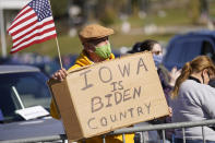 A person holds a sign during a campaign rally for Democratic presidential candidate former Vice President Joe Biden at the Iowa State Fairgrounds in Des Moines, Iowa, Friday, Oct. 30, 2020. (AP Photo/Andrew Harnik)