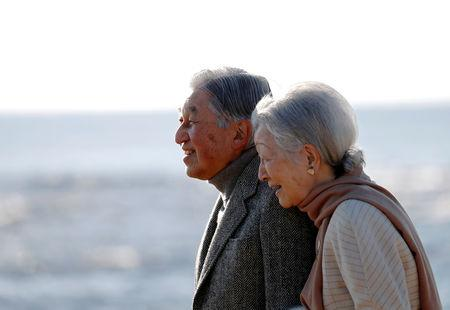 FILE PHOTO : Japan's Emperor Akihito and Empress Michiko stroll on a beach near their imperial villa, where they are staying for the emperor's recuperation, in Hayama town, south of Tokyo, Japan January 21, 2019. REUTERS/Issei Kato/File Photo