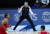 Ohio State head coach Chris Holtmann yells to his team as they played against Michigan in the first half of an NCAA college basketball game at the Big Ten Conference tournament in Indianapolis, Saturday, March 13, 2021. (AP Photo/Michael Conroy)