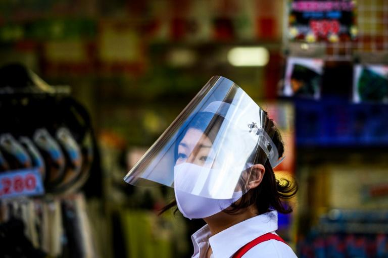 A widespread culture of mask-wearing has been cited as a possible reason for the low level of coronavirus in Tokyo (AFP Photo/Behrouz MEHRI)
