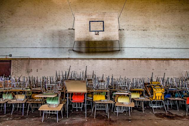 <p>A sports hall with stacked chairs. (Photo: Leland Kent/Caters News) </p>